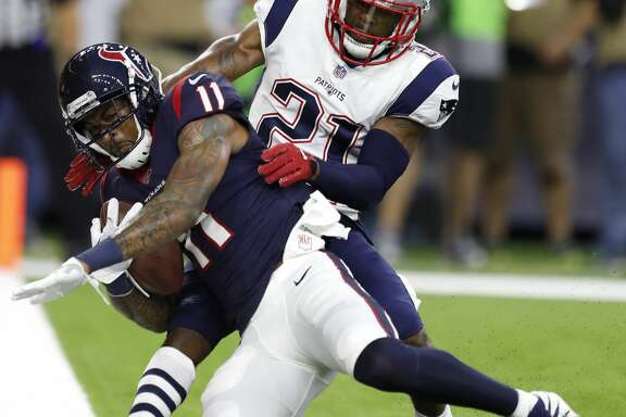 Houston Texans wide receiver Jaelen Strong (11) comes down with a 2-yard touchdown reception against New England Patriots cornerback Malcolm Butler (21) during the first quarter of an NFL preseason game at NRG Stadium, Saturday, Aug. 19, 2017, in Houston.  ( Karen Warren / Houston Chronicle )