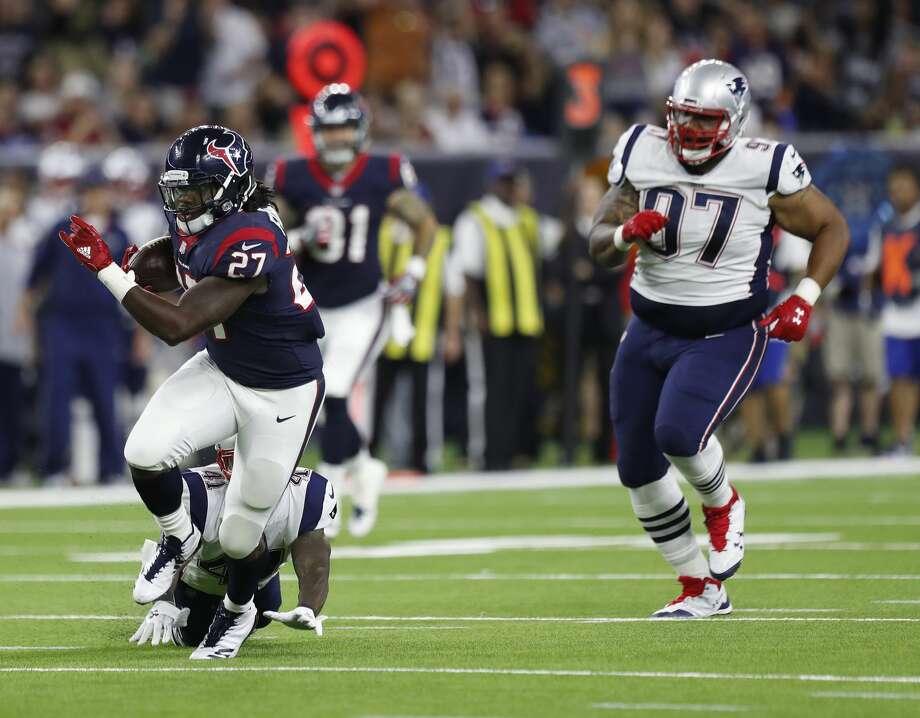Houston Texans running back D'Onta Foreman (27) gains yardage on a run during the third quarter of an NFL preseason game at NRG Stadium, Saturday, Aug. 19, 2017, in Houston.  ( Karen Warren / Houston Chronicle ) Photo: Karen Warren/Houston Chronicle