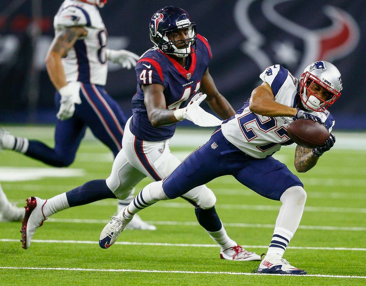HOUSTON, TX - AUGUST 19: D.J. Foster #27 of the New England Patriots makes a catch in front of Zach Cunningham #41 of the Houston Texans at NRG Stadium on August 19, 2017 in Houston, Texas. (Photo by Bob Levey/Getty Images)