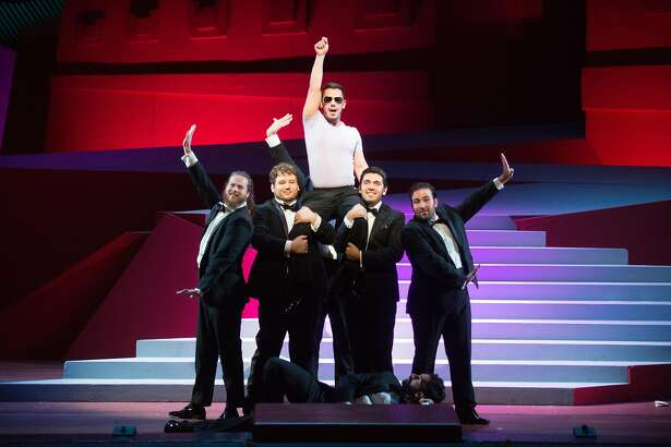 "Andres Acosta (center) in an aria from Donizetti's ""Rita"" at Merola Grand Finale"