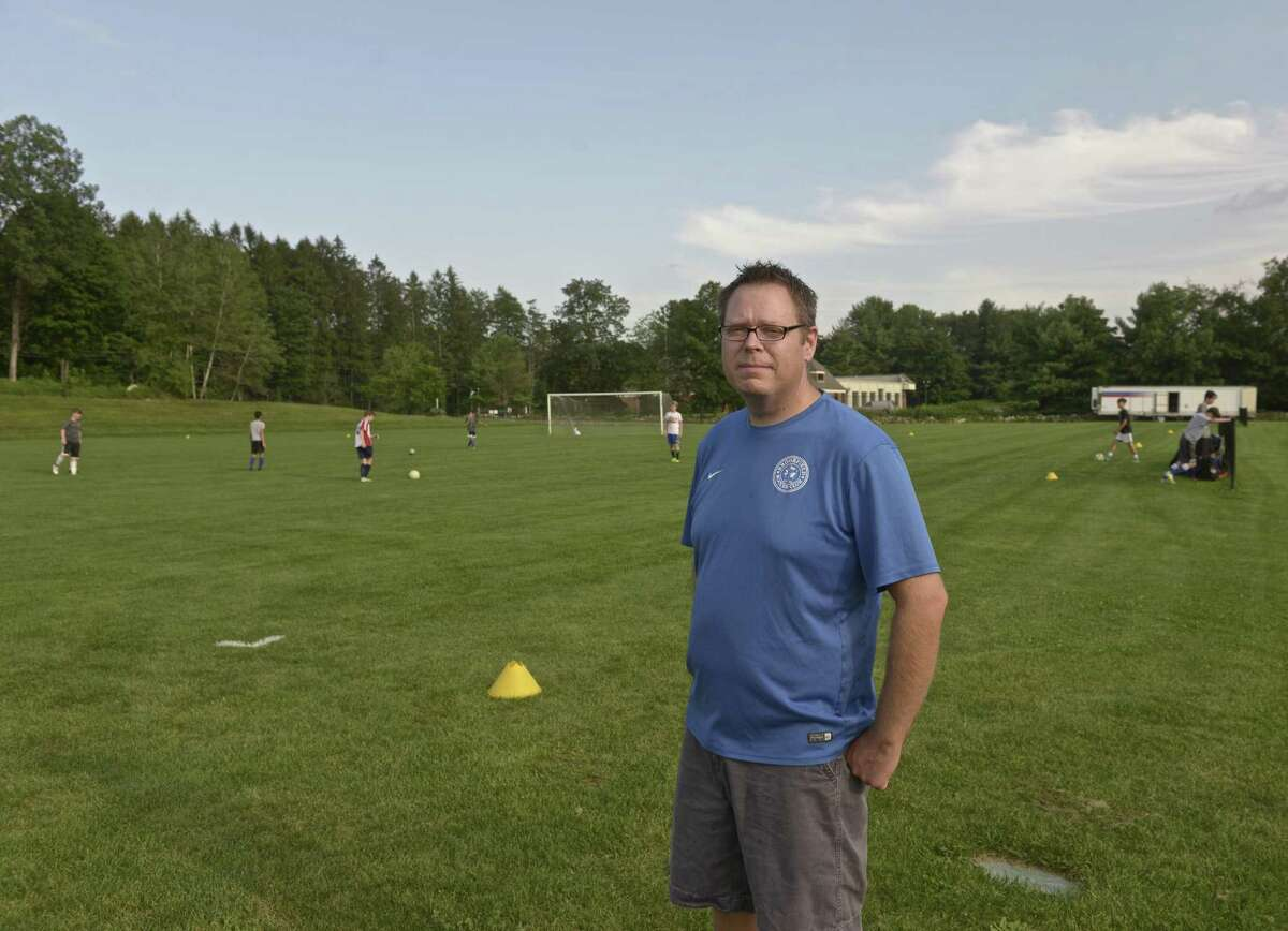 John Belles, President of the Brookfield Soccer Club, at one of the clubs summer camps on Horse Field, at the Brookfield Municipal Center. The field is the proposed location for the new Brookfield Library building. Thursday, August 10, 2017, in Brookfield, Conn.