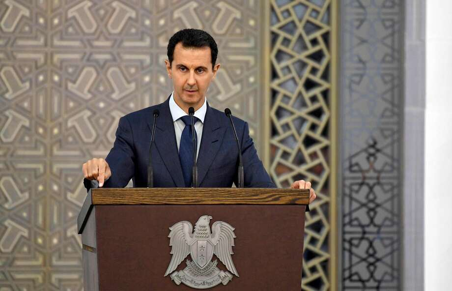 President Bashar Assad addresses members of Syria's diplomatic corps in Damascus. He demanded that Western countries cut ties with opposition and insurgent groups. Photo: STRINGER, AFP/Getty Images