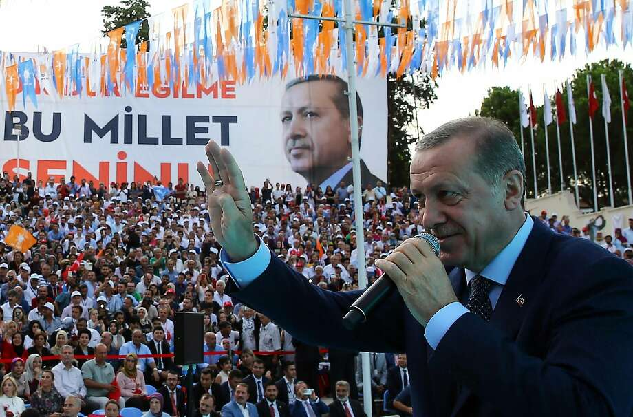 Turkish President Recep Tayyip Erdogan delivers a speech Saturday in Denizli. His security crackdown has caused thousands of university-educated professionals to flee to Germany. Photo: KAYHAN OZER, AFP/Getty Images