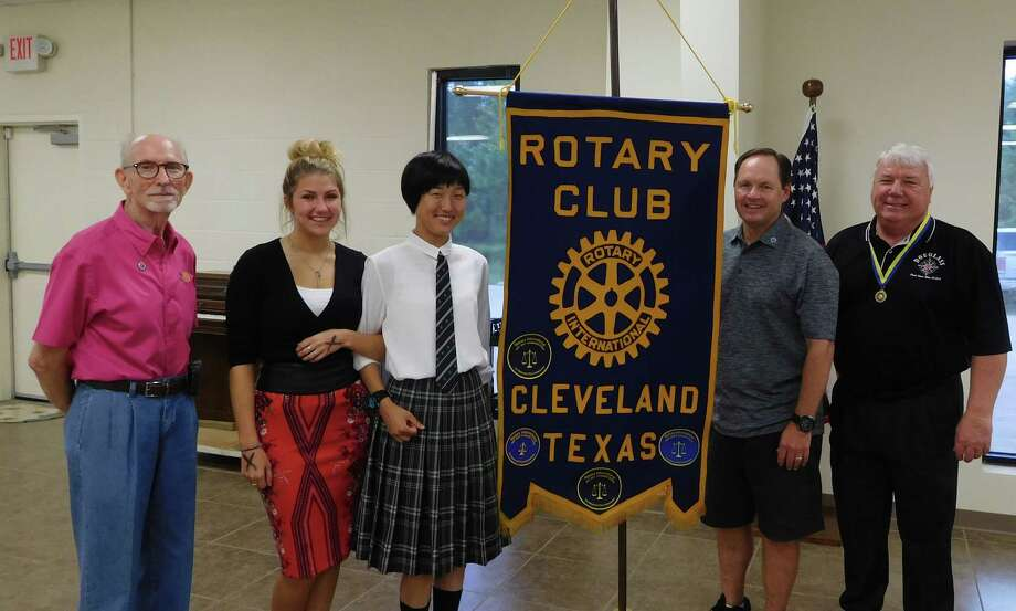 Cleveland ISD Superintendent Dr. Darrell Myers was presented the Rotary's Paul Harris Fellow Award by the Cleveland Rotary Club. Myers is a dedicated educator who has been guiding the expansion of the Cleveland schools and putting into action so many educational goals of the Rotary Club. Continuing the education theme, Rotary Youth Short Term Summer Exchange Students Savannah Litton of Tarkington High School and Yumi Yoshida of Maebashi, Gunma, Japan spoke of their experiences during their time studying culture, language, and building friendships: five weeks for Savannah and a month for Yumi. Pictured (left to right): Rotarian Tommie Daniel, Rotary Youth Exchange Students Savannah Litton of Tarkington and Yumi Yoshida of Japan, Rotary President Scott Lambert, Rotarian and Paul Harris Fellow Recipient Dr. Darrell Myers. Photo: Submitted