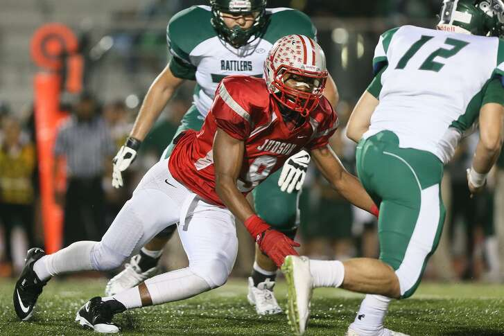 Judson's Alton Robinson (left) chases down Reagan's Byron Snape during the second half of their Class 6A Division I state quarterfinal game at Rutledge Stadium on Dec. 5, 2014.