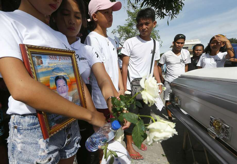 Relatives in Manila attend the funeral of Leover Miranda, who was killed in the drug crackdown. Photo: Bullit Marquez, Associated Press