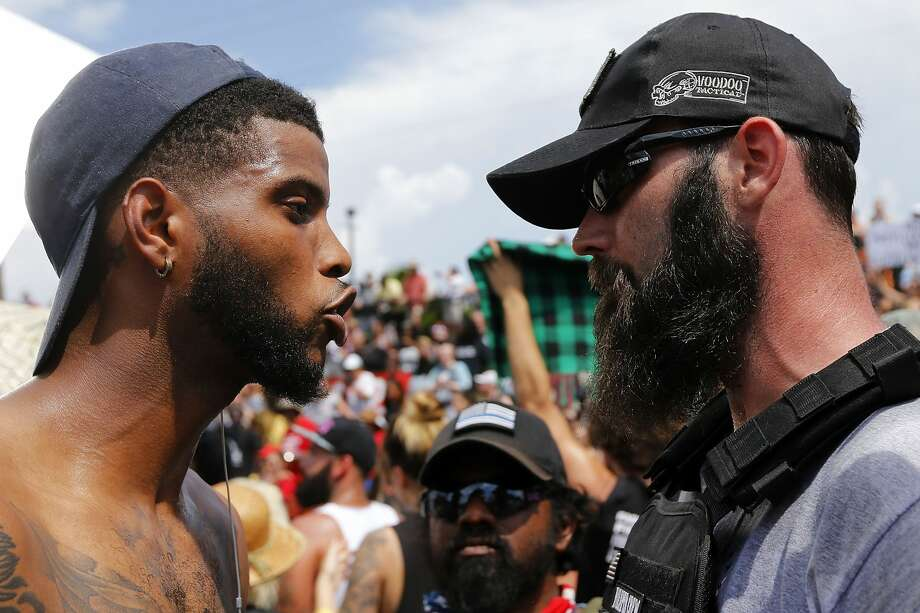 Protesters and counter-protesters argue during a demonstration on August 19, 2017 in New Orleans, Louisiana. The rally was held in solidarity with Charlottesville, where last week's alt-right rally resulted in the death of a protester.  Photo: Jonathan Bachman/Getty Images