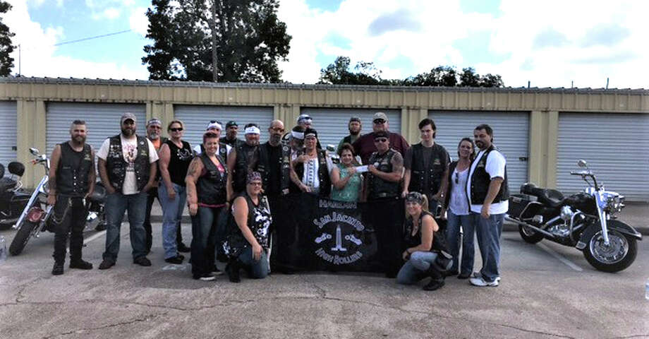 The Liberty County Child Welfare Board accepts a donation of $2,029.31 from the Hardin Chapter of the San Jacinto High Rollers Motorcycle Club. The money will be used for the Rainbow Room, which provides clothing and other items for children removed from their homes by Child Protective Services. Photo: Submitted