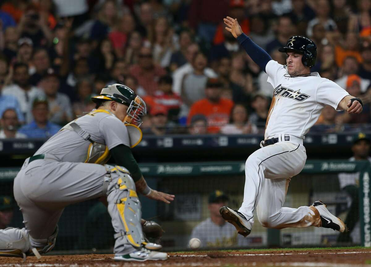 Houston Astros third baseman Alex Bregman (2) is out at home by Oakland Athletics catcher Bruce Maxwell (13) during the bottom fifth inning of the game at Minute Maid Park Saturday, Aug. 19, 2017, in Houston. ( Yi-Chin Lee / Houston Chronicle )