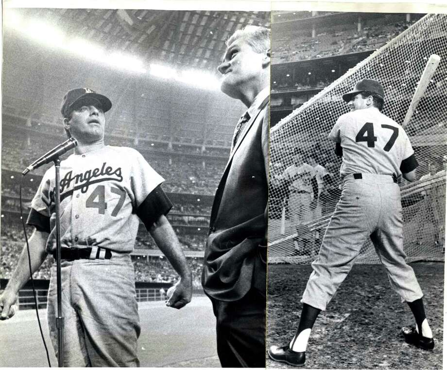 06/22/1966 - Comedian Jerry Lewis at Astrodome for Astros - Dodgers game. LEFT PHOTO: Lewis, in Dodger uniform, accepts key to city of Houston from councilman Johnny Goyen.  RIGHT PHOTO: Lewis takes batting practice. Photo: Darrell Davidson, Houston Chronicle / Houston Chronicle