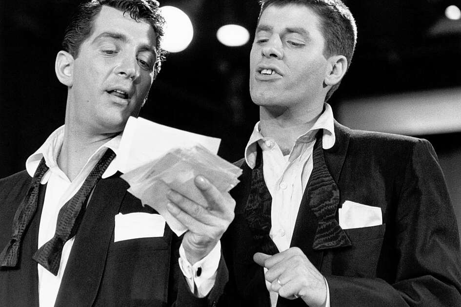 Comedians Dean Martin and Jerry Lewis on the set of a fundraising television program. (Photo by mary delaney cooke/Corbis via Getty Images)
