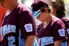 Fairfield American player Griffin Dodder hangs his head after the team was defeated by Lufkin, TX during Little League World Series action at Lamade Stadium in South Williamsport, Penn., on Sunday Aug. 20, 2017.