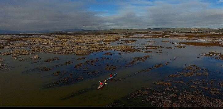 In a video image captured from a drone, biologist Robert Eddings and Chronicle outdoors writer Tom Stienstra paddle�kayaks�in the privately-owned Grizzly Ranch section of the 88,000-acre Suisun Marsh