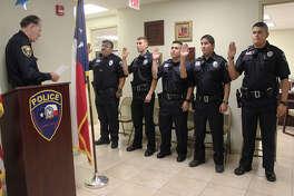 Ray Garner, UISD chief of police, swears in new police officers Patrick Mendoza, Greg Cantu, Antonio Perez, Charles Dickenson and Ricardo Lopez.