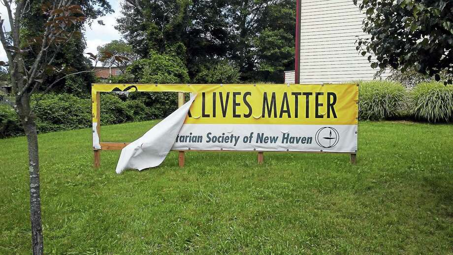 A banner outside a Hamden Unitarian church was vandalized this weekend, officials say. Photo: Courtesy Of Unitarian Society Of New Haven