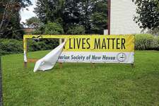 A banner outside a Hamden Unitarian church was vandalized this weekend, officials say.
