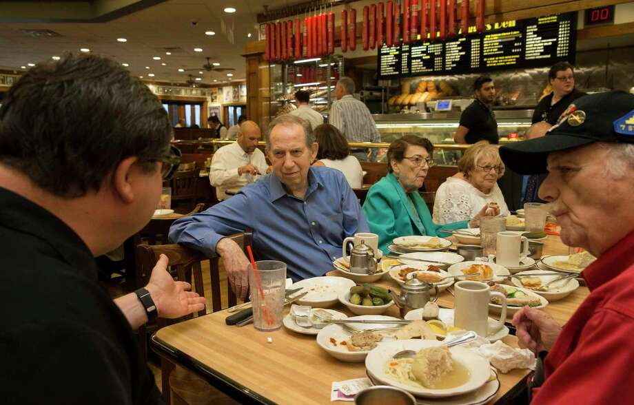 Gruber, co-owner of Kenny & Ziggy's New York Delicatessen, chats with, from left, Ben Waserman, Rosine Chappell, Ruth Steinfeld and Bill Orlin in Houston. Photo: Yi-Chin Lee, Houston Chronicle / © 2017  Houston Chronicle