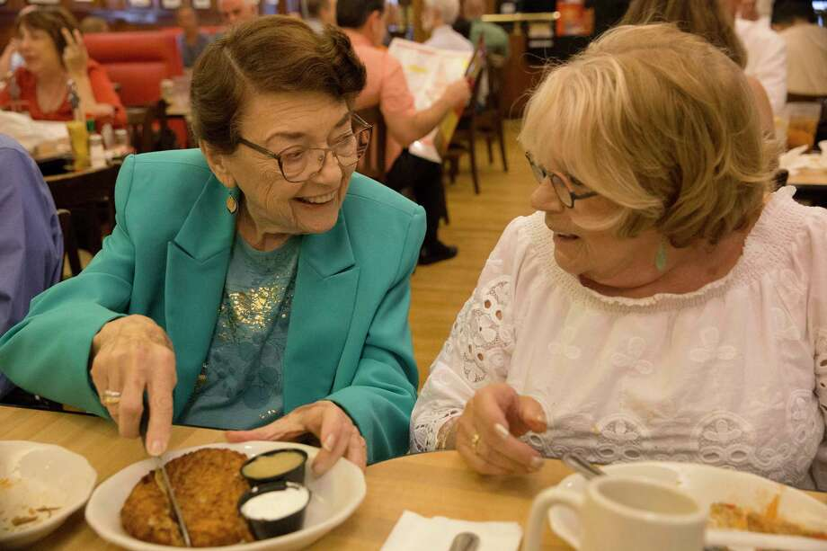 Holocaust survivors Rosine Chappell, left, and Ruth Steinfeld share a potato latke at Kenny & Ziggy's New York Delicatessen in Houston. Photo: Yi-Chin Lee, Houston Chronicle / © 2017  Houston Chronicle