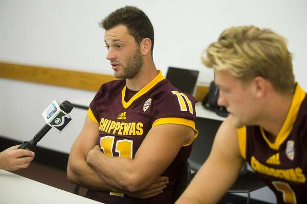 Central Michigan University quarterbacks Shane Morris, left, and Tony Poljan, right, answer questions during a press conference on Sunday at the Central Michigan University Student Activity Center in Mt. Pleasant.