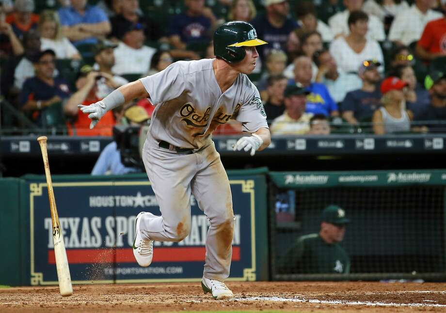Oakland Athletics' Boog Powell watches his ground ball single to center field against the Houston Astros in the seventh inning of a baseball game, Sunday, Aug. 20, 2017, in Houston. (AP Photo/Richard Carson) Photo: Richard Carson, Associated Press
