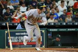 Oakland Athletics' Boog Powell watches his ground ball single to center field against the Houston Astros in the seventh inning of a baseball game, Sunday, Aug. 20, 2017, in Houston. (AP Photo/Richard Carson)