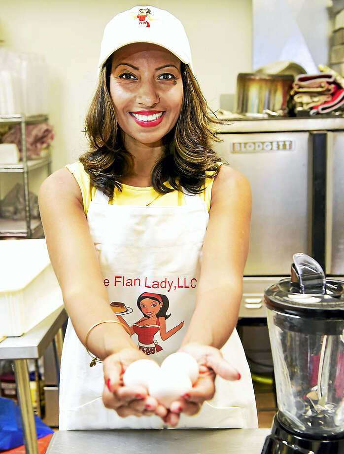 """It's all about the eggs,"" says Johanna Torres of Branford, known as the Flan Lady, in the kitchen that she rents by the hour and bakes her famous flan receipt at the Moon Rocks Gourmet Cookie shop in Hamden. Photo: Peter Hvizdak / Hearst Connecticut Media / New Haven Register"