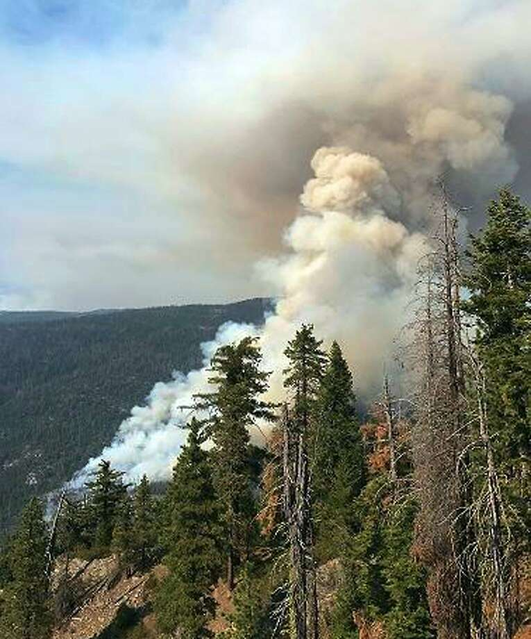 This photo provided by inciweb.nwcg.gov shows a fire burning near the town of Wawona, Calif., within Yosemite National Park in California's Sierra Nevada Monday, Aug. 14, 2017. Flames from the South Fork fire have come within 2 miles (3 kilometers) of Wawona, a tiny community near the park's south entrance that swells this time of year with up to 2,000 visitors attending a church camp and renting cabins around a market and small library. A lightning strike in recent weeks may be to blame for the blaze that erupted into a wildfire on Sunday afternoon, Yosemite spokesman Scott Gediman said. (inciweb.nwcg.gov via AP) Photo: Associated Press