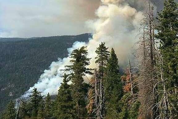 This photo provided by inciweb.nwcg.gov shows a fire burning near the town of Wawona, Calif., within Yosemite National Park in California's Sierra Nevada Monday, Aug. 14, 2017. Flames from the South Fork fire have come within 2 miles (3 kilometers) of Wawona, a tiny community near the park's south entrance that swells this time of year with up to 2,000 visitors attending a church camp and renting cabins around a market and small library. A lightning strike in recent weeks may be to blame for the blaze that erupted into a wildfire on Sunday afternoon, Yosemite spokesman Scott Gediman said. (inciweb.nwcg.gov via AP)