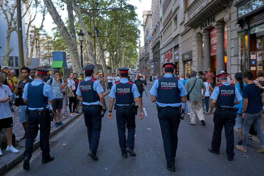 Police patrol Las Ramblas, where a van mowed down pedestrians Thursday, killing 13, in Barcelona, Spain, Aug. 20, 2017. As the nation grieved, the hunt continued for Younes Abouyaaqoub, a 22-year-old Moroccan-born man who the authorities said might have driven the van on the famous promenade. (Samuel Aranda/The New York Times) Photo: SAMUEL ARANDA, NYT