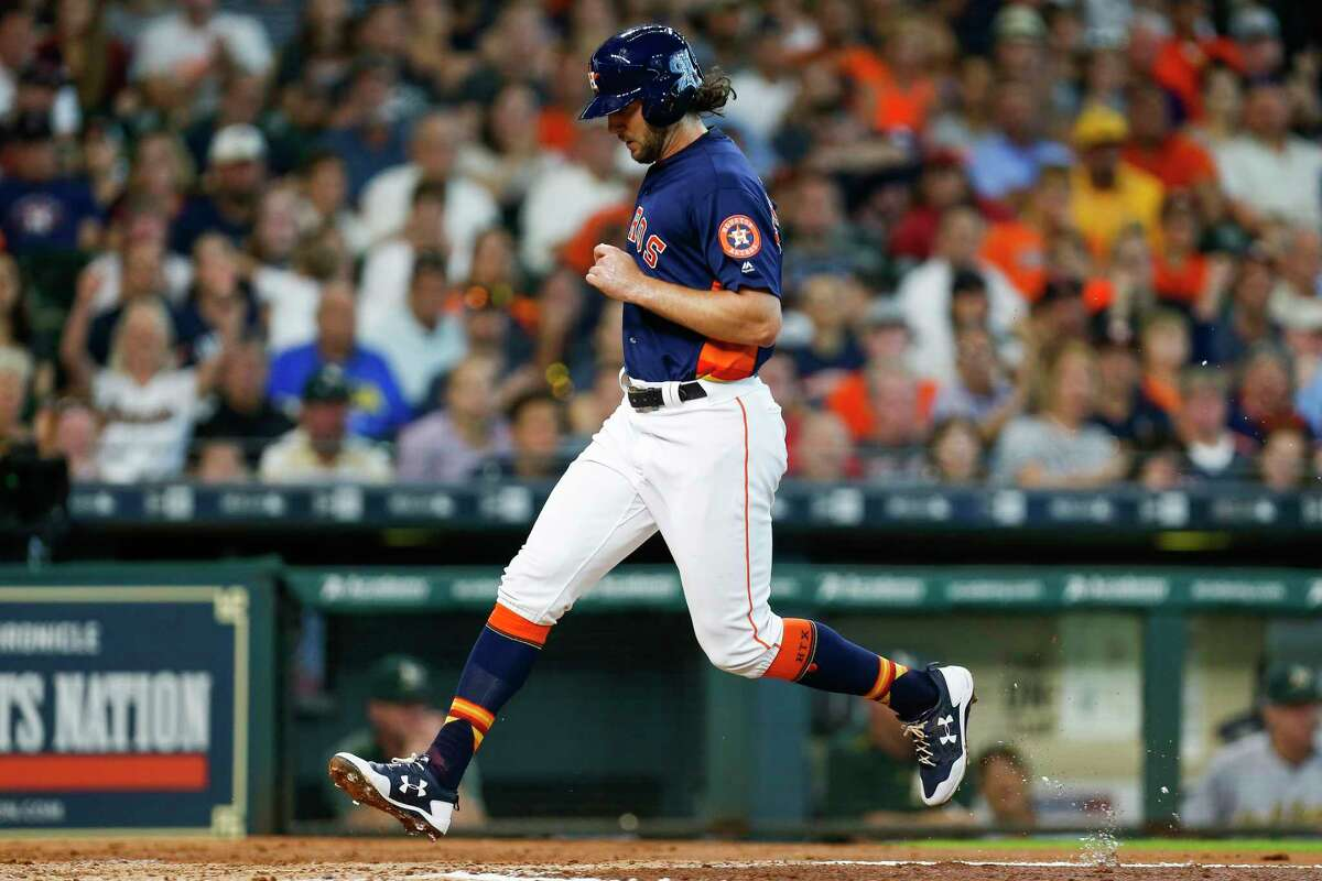 Houston Astros center fielder Jake Marisnick (6) scores on a fly ball by short stop Alex Bregman (2)as the Houston Astros take on the Oakland Athletics in the third inning at Minute Maid Park Sunday, Aug. 20, 2017 in Houston.