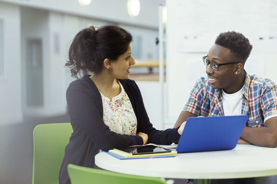 The more your teacher knows about you as a person and your educational  goals, the more likely that teacher will go to bat for you in the letter of recommendation. Photo: Caiaimage / Robert Daly / Getty Images