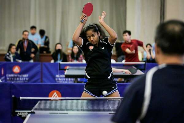 Lavanya Maruthapandian, 14, hits the ball while playing ping pong at the Old St. Mary's Cathedral during the annual Chinatown ping-pong festival in San Francisco, Calif., on Sunday, Aug. 20, 2017.