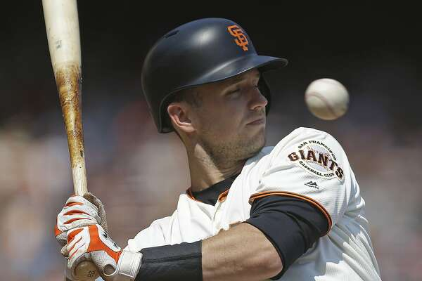 San Francisco Giants' Buster Posey closes his eyes as he leans away from a high inside pitch from Philadelphia Phillies' Ben Lively in the fourth inning of a baseball game, Sunday, Aug. 20, 2017, in San Francisco. (AP Photo/Ben Margot)