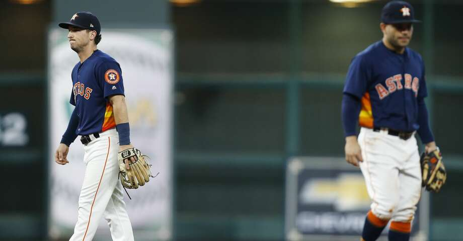 PHOTOS: Astros vs. AthleticsHouston Astros short stop Alex Bregman (2), left, reacts after a two-error play put the Houston Astros down 0-2 against the Oakland Athletics in the first inning at Minute Maid Park Sunday, Aug. 20, 2017 in Houston. ( Michael Ciaglo / Houston Chronicle )Browse through the photos to see action from Sunday's tilt between the Astros and A's. Photo: Michael Ciaglo/Houston Chronicle