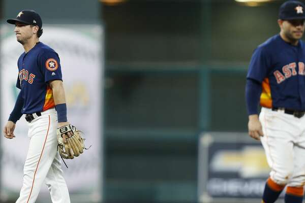 Houston Astros short stop Alex Bregman (2), left, reacts after a two-error play put the Houston Astros down 0-2 against the Oakland Athletics in the first inning at Minute Maid Park Sunday, Aug. 20, 2017 in Houston. ( Michael Ciaglo / Houston Chronicle )
