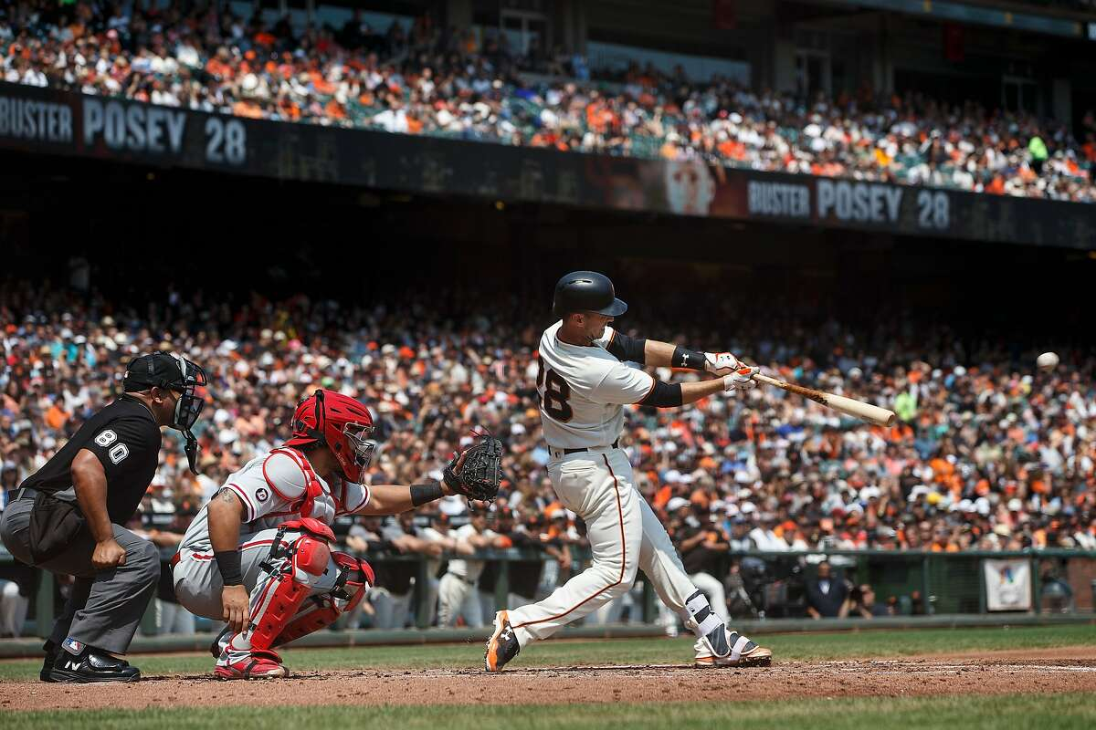 SAN FRANCISCO, CA - AUGUST 20: Buster Posey #28 of the San Francisco Giants hits a double against the Philadelphia Phillies during the second inning at AT&T Park on August 20, 2017 in San Francisco, California. (Photo by Jason O. Watson/Getty Images)