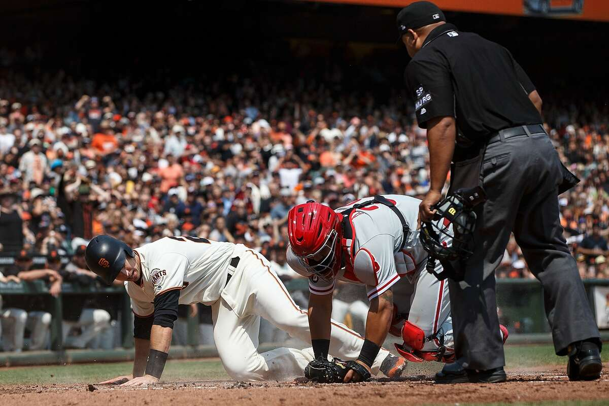 SAN FRANCISCO, CA - AUGUST 20: Buster Posey #28 of the San Francisco Giants is tagged out at home plate by Jorge Alfaro #38 of the Philadelphia Phillies in front of umpire Adrian Johnson #80 during the second inning at AT&T Park on August 20, 2017 in San Francisco, California. (Photo by Jason O. Watson/Getty Images)