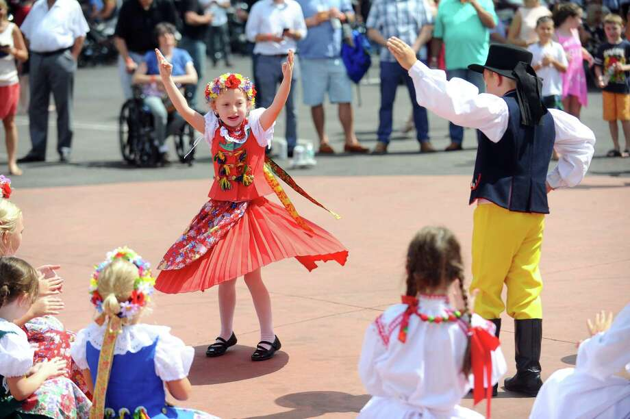 Seven-year-old Julia Liverpool spins while participating in a traditional Polish dance during the annual Dozynki Festival at the Holy Name of Jesus Church in Stamford, Conn. on Sunday, August 20, 2017. Photo: Michael Cummo / Hearst Connecticut Media / Stamford Advocate