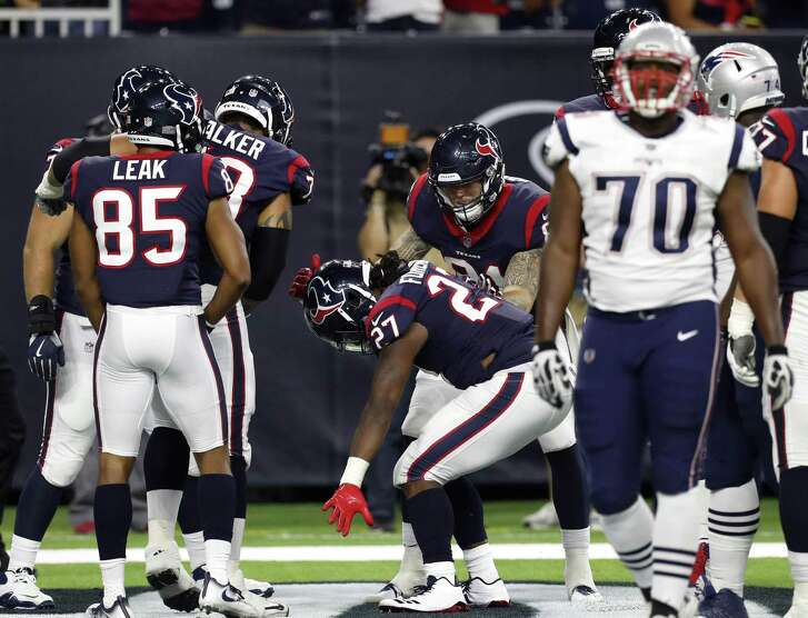 D'Onta Foreman (27) celebrates his four-yard touchdown run in the fourth quarter of the Texans' preseason victory Saturday.