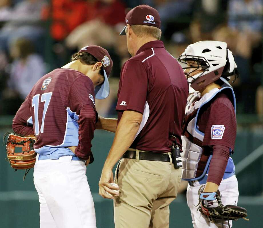 Fairfield American manager Mike Randazzo, center, comforts pitcher Matthew Vivona (17) after taking the ball from him to make a pitching change in the second inning Thursday. Photo: Gene J. Puskar — The Associated Press / Copyright 2017 The Associated Press. All rights reserved.