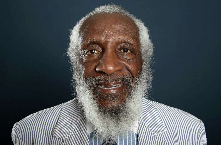 FILE - In this July 21, 2012 file photo, comedian and activist Dick Gregory poses for a portrait during the PBS TCA Press Tour in Beverly Hills, Calif. Gregory, the comedian and activist and who broke racial barriers in the 1960s and used his humor to spread messages of social justice and nutritional health, has died. He was 84. Gregory died late Saturday, Aug. 19, 2017, in Washington, D.C. after being hospitalized for about a week, his son Christian Gregory told The Associated Press. He had suffered a severe bacterial infection. (Photo by Matt Sayles/Invision/AP, File) Photo: Matt Sayles, INVL / Invision