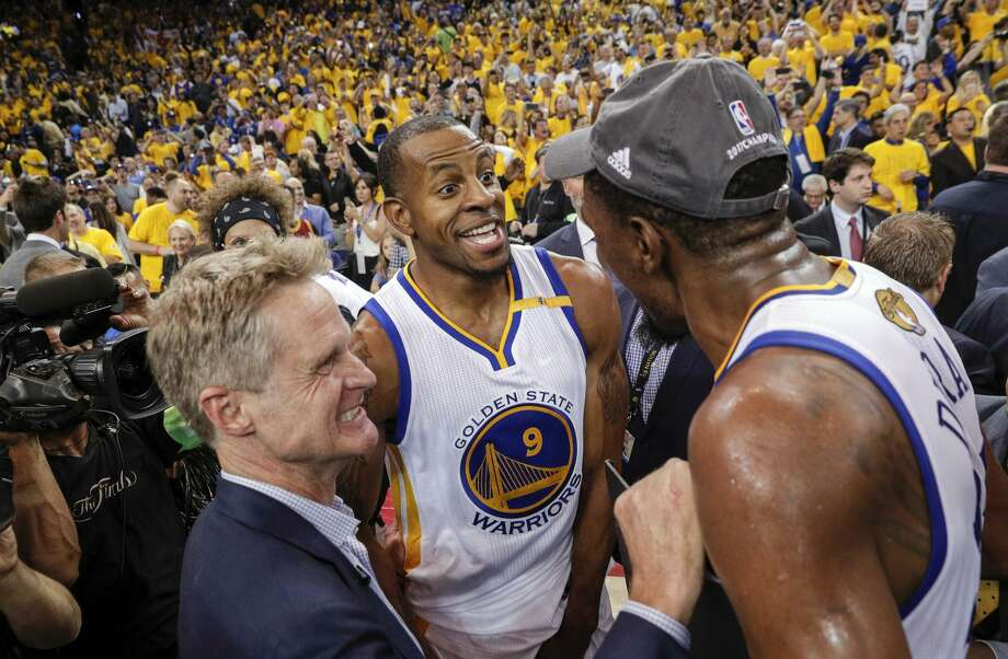 Warriors head coach Steve Kerr, swingman Andre Iguodala (center) and forward Kevin Durant share the moment after after defeating the Cleveland Cavaliers in Game 5 at Oracle Arena to win their second NBA championship in three years. Photo: Carlos Avila Gonzalez / The Chronicle / online_yes