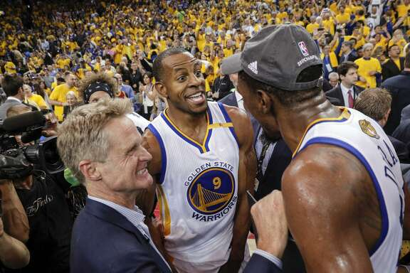 Warriors head coach Steve Kerr, swingman Andre Iguodala (center) and forward Kevin Durant share the moment after after defeating the Cleveland Cavaliers in Game 5 at Oracle Arena to win their second NBA championship in three years.