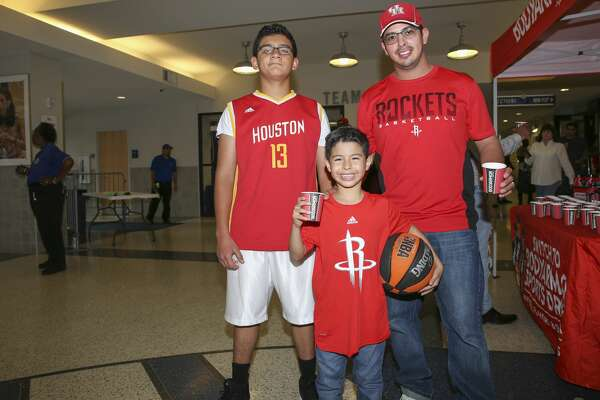 People pose for a photo during James Harden charity basketball tournament at Rice University's Tudor Field House Sunday, Aug. 20, 2017, in Houston. ( Yi-Chin Lee / Houston Chronicle )