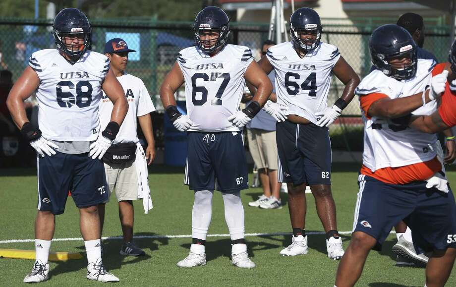 Offensive linemen Austin Pratt (68), Kyle McKinney (67) and Josh Dunlop (64) wait for the next drill at UTSA Roadrunners practice on Aug. 18, 2017. Photo: Tom Reel /San Antonio Express-News / 2017 SAN ANTONIO EXPRESS-NEWS