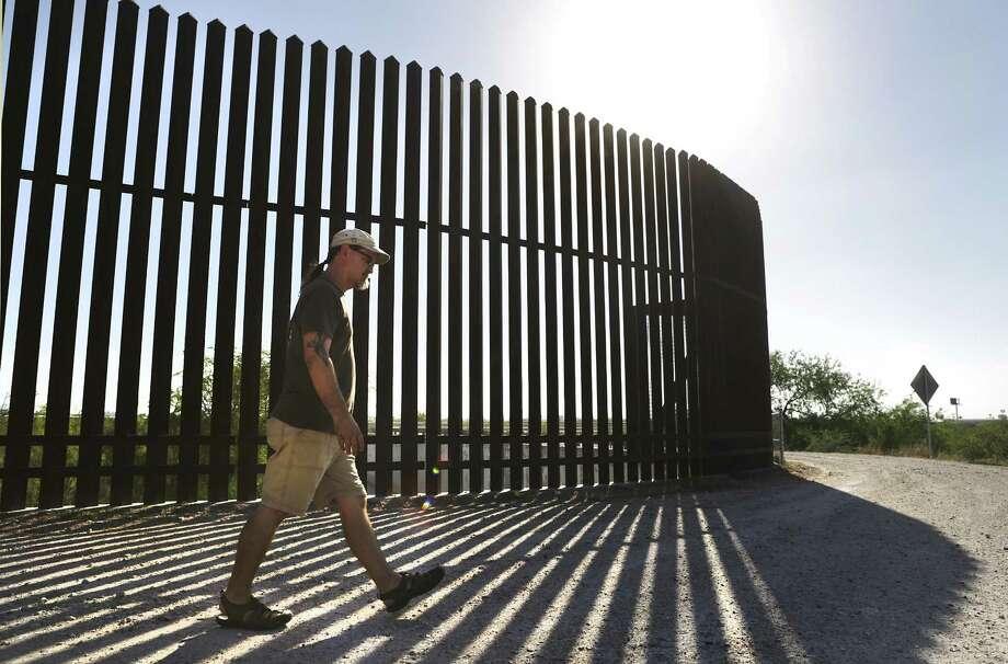 The Sierra Club's Scott Nicol walks near the border wall at the Old Hidalgo Pumphouse Museum and World Birding Center. Photo: Bob Owen /San Antonio Express-News / ©2017 San Antonio Express-News