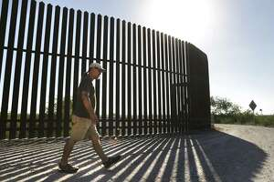 The Sierra Club's Scott Nicol walks near the border wall at the Old Hidalgo Pumphouse Museum and World Birding Center.