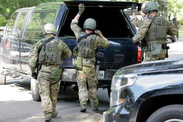 """Armed FBI agents in tactical gear arrive at the crime scene as the Houston Police, ATF and the FBI responded to a """"special assignment"""" in the 2000 block of Albans Sunday, Aug. 20, 2017, in Houston."""