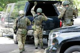 "Armed FBI agents in tactical gear arrive at the crime scene as the Houston Police, ATF and the FBI responded to a ""special assignment"" in the 2000 block of Albans Sunday, Aug. 20, 2017, in Houston."
