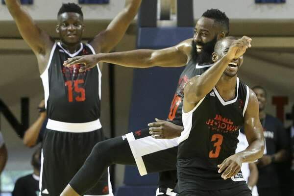 Big Tony's Chris Paul (3) celebrates with James Harden after scoring a big slam dunk with Harden's assist during the NBA game of James Harden charity basketball tournament against La Flame at Rice University's Tudor Field House Sunday, Aug. 20, 2017, in Houston. ( Yi-Chin Lee / Houston Chronicle )